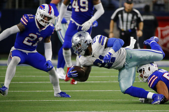 Buffalo Bills safety Jordan Poyer (21) and linebacker Matt Milano, right, stop Dallas Cowboys running back Ezekiel Elliott (21) from gaining extra yards on a run in the first half of an NFL football game in Arlington, Texas, Thursday, Nov. 28, 2019. (AP Photo/Michael Ainsworth)