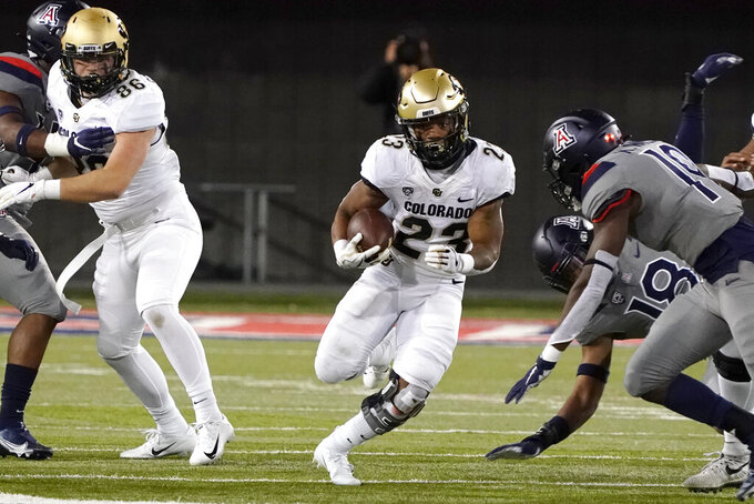 Colorado running back Jarek Broussard (23) runs for a first down against Colorado during the first half of an NCAA college football game Saturday, Dec. 5, 2020, in Tucson, Ariz. (AP Photo/Rick Scuteri)