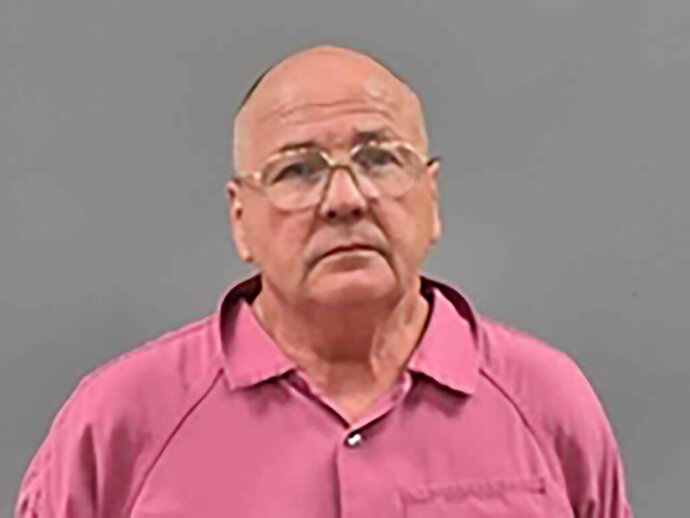 In this Aug. 19, 2019 booking photo provided by the Lawrence County, Missouri, Sheriff's Office is Lawrence Gene Timmons. Timmons has been indicted in the August 1988, killing of a young mother, Cynthia Smith, of Aurora, Mo., in southwest Missouri. Timmons is scheduled to be arraigned Tuesday on one count of first-degree murder in the death of Smith, and also faces multiple counts of forgery and unlawful possession of a firearm in unrelated cases.(Lawrence County Sheriff's Office via AP)