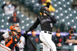 Colorado Rockies' Charlie Blackmon, right, pops out as San Francisco Giants catcher Buster Posey looks on in the seventh inning of game one of a baseball doubleheader Tuesday, May 4, 2021, in Denver. The Giants won the opening game of the twinbill by a score of 12-4. (AP Photo/David Zalubowski)
