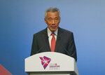 Prime Minister Lee Hsien Loong of Singapore, addresses delegates during the opening ceremony for the 33rd ASEAN Summit and Related Summits Tuesday, Nov. 13, 2018, in Singapore. The summit is expected to discuss the South China Sea issue, maritime security and terrorism. (AP Photo/Bullit Marquez)