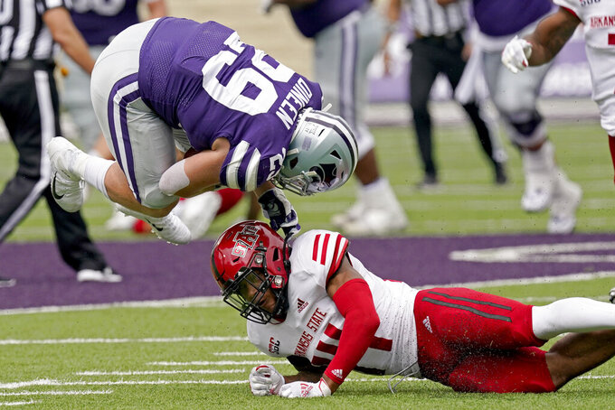 Kansas State fullback Jax Dineen (29) is upended by Arkansas State defensive back Antonio Fletcher (14) after catching a pass during the second half of an NCAA college football game Saturday, Sept. 12, 2020, in Manhattan, Kan. (AP Photo/Charlie Riedel)