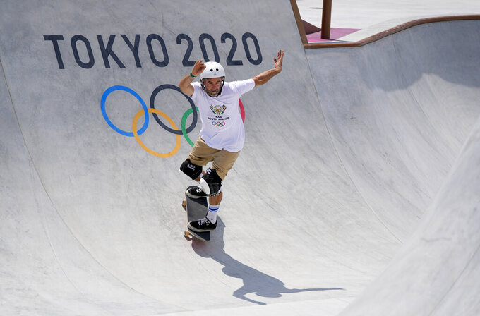 Dallas Oberholzer, 46, from South Africa, takes part in a men's park skateboarding training session at the 2020 Summer Olympics, Saturday, July 31, 2021, in Tokyo, Japan. The age-range of competitors in skateboarding's Olympic debut at the Tokyo Games is remarkably broad and 46-year-old Dallas Oberholzer will go wheel-to-wheel with skaters less than half his age. (AP Photo/Ben Curtis)