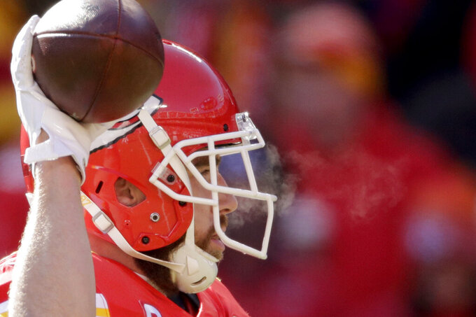 Kansas City Chiefs' Travis Kelce warms up before the NFL AFC Championship football game against the Tennessee Titans Sunday, Jan. 19, 2020, in Kansas City, MO. (AP Photo/Charlie Riedel)