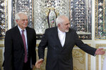 Iranian Foreign Minister Mohammad Javad Zarif, left, welcomes European Union foreign policy chief Josep Borrell, for their meeting in Tehran, Iran, Monday, Feb. 3, 2020. (AP Photo/Ebrahim Noroozi)