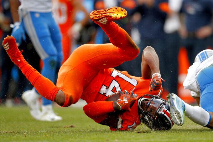 Denver Broncos wide receiver Courtland Sutton (14) is tackled by Detroit Lions cornerback Darius Slay during the first half of an NFL football game, Sunday, Dec. 22, 2019, in Denver. (AP Photo/David Zalubowski)
