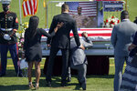 Mourners pay their respects to Sgt. Johanny Rosario Pichardo, a U.S. Marine who was among 13 service members killed in a suicide bombing in Afghanistan, during a public wake in her hometown of Lawrence, Mass., Tuesday, Sept. 14, 2021. (AP Photo/David Goldman)