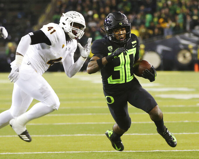 Oregon's Jaylon Redd, right, outruns Arizona State's Tyler Johnson on his way to a second quarter touchdown in an NCAA college football game Saturday, Nov. 17, 2018, in Eugene, Ore. (AP Photo/Chris Pietsch)