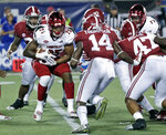 FILE - In this Sept. 1, 2018. file photo, Alabama defenders, including defensive back Deionte Thompson (14), linebacker Christian Miller (47) and defensive lineman Quinnen Williams (92), close in on Louisville running back Dae Williams (25) , during the second half of an NCAA college football game in Orlando, Fla. Alabama's defense, for a change, has been overshadowed by the offense, but it's still formidable. (AP Photo/John Raoux, File))