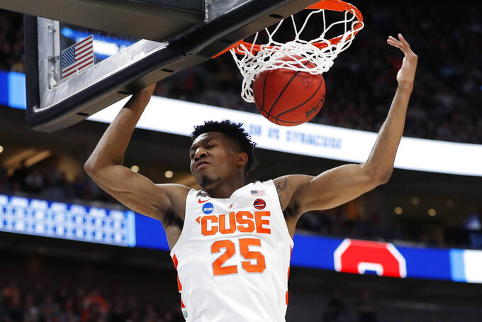 Syracuse guard Tyus Battle dunks against Baylor during the second half against Baylor in a first-round game in the NCAA men's college basketball tournament Thursday, March 21, 2019, in Salt Lake City. (AP Photo/Jeff Swinger)