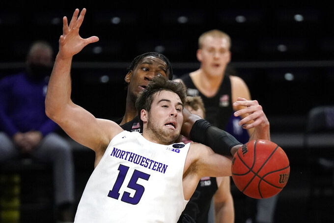Northwestern center Ryan Young (15) battles for a rebound against Michigan State forward Aaron Henry during the second half of an NCAA college basketball game in Evanston, Ill., Sunday, Dec. 20, 2020. Northwestern won 79-65. (AP Photo/Nam Y. Huh)