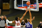 Kansas State forward David Bradford (21) drives to the basket ahead of Iowa State guard Darlinstone Dubar (55) during the first half of an NCAA college basketball game, Tuesday, Dec. 15, 2020, in Ames, Iowa. (AP Photo/Charlie Neibergall)
