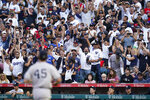 Fans cheer after New York Yankees starting pitcher Gerrit Cole strikes out Los Angeles Angels' Jared Walsh during the sixth inning of a baseball game Wednesday, Sep. 1, 2021, in Anaheim, Calif. (AP Photo/Ashley Landis)