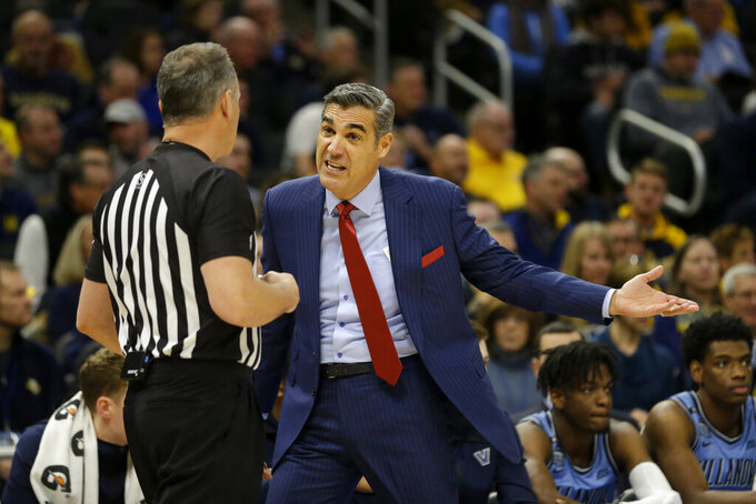 Villanova head coach Jay Wright argues with an official during the first half of an NCAA college basketball game against Marquette, Saturday, Jan. 4, 2020, in Milwaukee. (AP Photo/Aaron Gash)