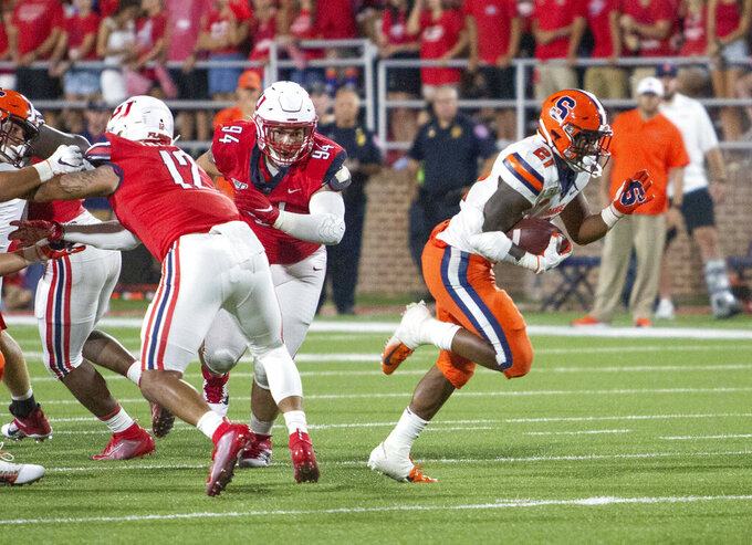 Syracuse running back Moe Neal breaks free to score a touchdown during the second half against Liberty in an NCAA college football game in Lynchburg, Va. Saturday, Aug. 31, 2019. (AP Photo/Matt Bell)