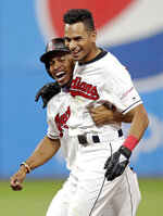 Cleveland Indians' Oscar Mercado, right, celebrates with Francisco Lindor after Mercado hit a game-winning RBI-single off Cincinnati Reds relief pitcher Raisel Iglesias in the tenth inning in a baseball game, Tuesday, June 11, 2019, in Cleveland. Mike Freeman scored on the play. The Indians won 2-1 in ten innings. (AP Photo/Tony Dejak)