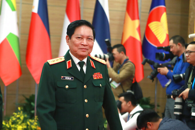 Vietnamese Defense Minister Ngo Xuan Lich arrives at the venue for the online ASEAN Summit in Hanoi, Vietnam on Thursday, Nov. 12, 2020. (AP Photo/Hau Dinh)