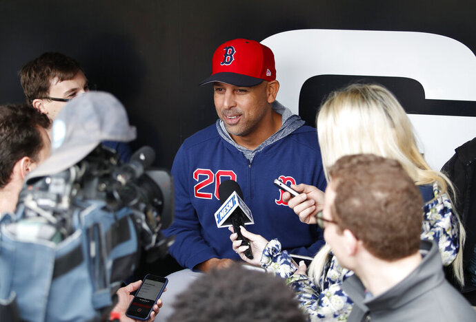 Boston Red Sox manager Alex Cora (20) talks with the media before a baseball game against the Chicago White Sox in Chicago, Friday, May 3, 2019. (AP Photo/Jeff Haynes)