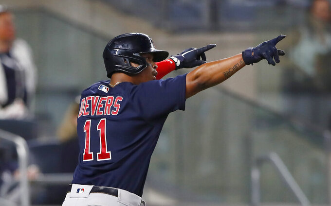 Boston Red Sox's Rafael Devers celebrates after scoring against the New York Yankees during the eighth inning of a baseball game Saturday, June 5, 2021, in New York. (AP Photo/Noah K. Murray)