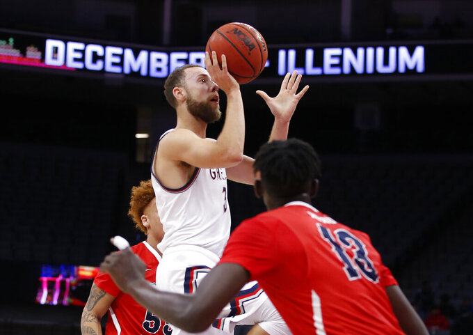Saint Mary's guard jordan Ford, center, goes up for a shot in front of Fresno State guard Aguir Agau, right, during the first half of an NCAA college basketball game in Sacramento, Calif., Wednesday, Nov. 20, 2019. (AP Photo/Rich Pedroncelli)