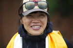 Tsang Yin-hung, 45, of Hong Kong who scaled Mount Everest from the base camp in 25 hours and 50 minutes, and became the fastest female climber arrives in Kathmandu, Nepal, Sunday, May 30, 2021. The Hong Kong teacher and retired attorney from Chicago who became the oldest American to scale Mount Everest, on Sunday returned safely from the mountain where climbing teams have been struggling with bad weather and a coronavirus outbreak. (AP Photo/Bikram Rai)