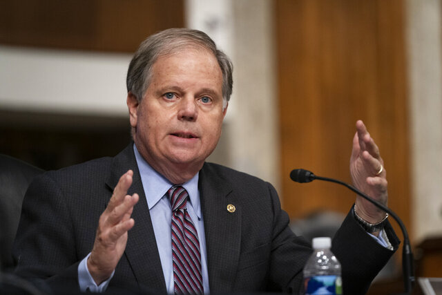Sen. Doug Jones, D-Ala., questions witnesses during a Senate Senate Health, Education, Labor, and Pensions Committee Hearing on the federal government response to COVID-19 on Capitol Hill Wednesday, Sept. 23, 2020, in Washington. (Alex Edelman/Pool via AP)