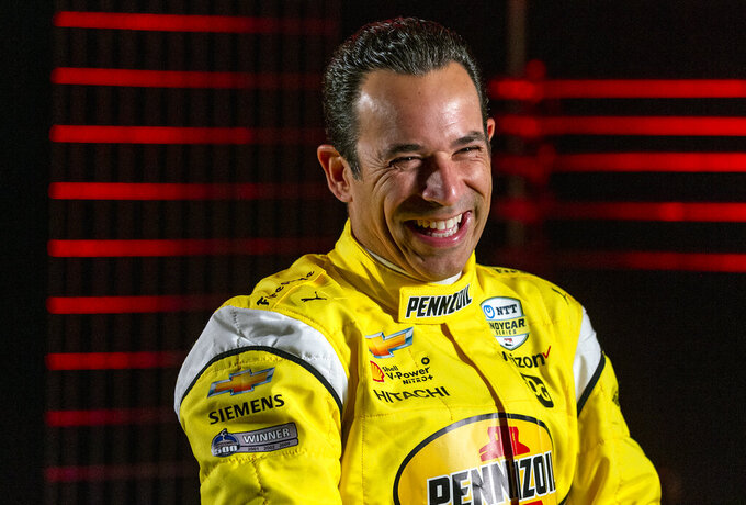 IndyCar driver Helio Castroneves is interviewed during IndyCar auto racing media day, Monday, Feb. 11, 2019, in Austin, Texas. (AP Photo/Stephen Spillman)