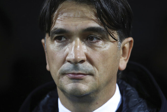 FILE - In this Saturday, Nov. 16, 2019 file photo, Croatia coach Zlatko Dalic looks at the field prior to the Euro 2020 group E qualifying soccer match between Croatia and Slovakia at the Rujevica stadium in Rijeka, Croatia. The last two World Cup winners (Joachim Loew of Germany and Didier Deschamps of France). The defending European champion (Fernando Santos of Portugal). And a World Cup finalist (Zlatko Dalić of Croatia). Not to mention a Champions League winner (Luis Enrique of Spain) and a Premier League champion (Roberto Mancini of Italy). There is no shortage of accomplished coaches at the European Championship. (AP Photo/Daniel Kasap, File)