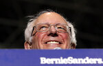 FILE - In this March 3, 2019 file photo, Sen. Bernie Sanders, I-Vt., smiles as he kicks off his 2020 presidential campaign at Navy Pier in Chicago. By the time California's presidential primary finally arrived in 2016,  Sanders was a beaten man. This time around, everything has changed. Sanders arrives in California this week for rallies in San Diego, Los Angeles and San Francisco with the state's vast trove of delegates in play for 2020, no front-runner in a crowded Democratic presidential field and a left-leaning electorate looking favorably on his signature proposals. (AP Photo/Nam Y. Huh, File)