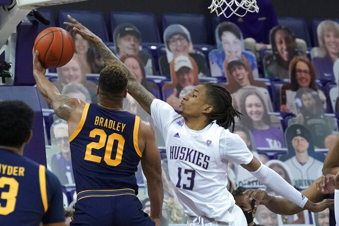 Washington forward Hameir Wright (13) blocks a shot by California guard Matt Bradley (20) during the first half of an NCAA college basketball game Saturday, Feb. 20, 2021, in Seattle. (AP Photo/Ted S. Warren)