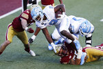 Boston College linebacker Isaiah McDuffie, bottom, stops North Carolina running back Michael Carter (8) during the first half of an NCAA college football game, Saturday, Oct. 3, 2020, in Boston. (AP Photo/Michael Dwyer)