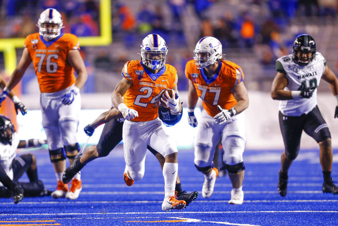 Boise State running back George Holani (24) breaks away from the Hawaii defense for a 40-yard touchdown run in the second half of an NCAA college football game, Sunday, Oct. 13, 2019, in Boise, Idaho. Boise State won 59-37. (AP Photo/Steve Conner)