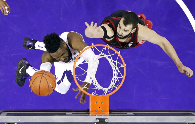 Washington's Jaylen Nowell, left, shoots and scores as Stanford's Josh Sharma defends during the first half of an NCAA college basketball game Thursday, Jan. 17, 2019, in Seattle. (AP Photo/Elaine Thompson)