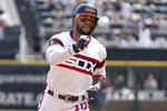 Chicago White Sox's Yoan Moncada rounds the bases after hitting a solo home run during the fourth inning of a baseball game against the Houston Astros in Chicago, Sunday, July 18, 2021. (AP Photo/Nam Y. Huh)