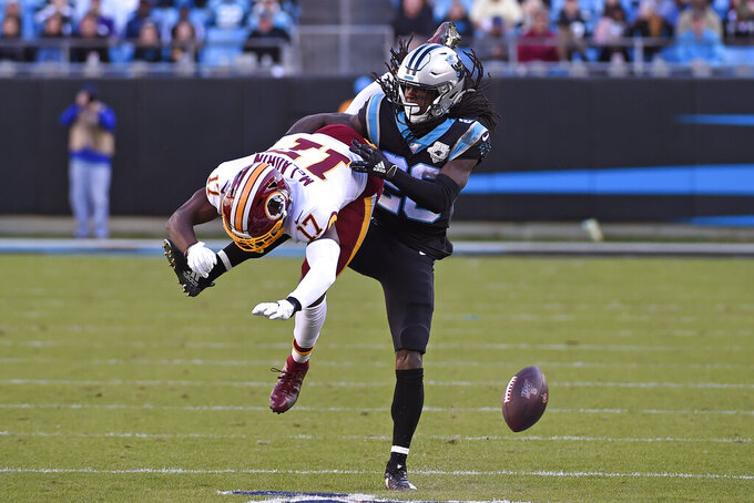 Carolina Panthers cornerback Donte Jackson defends while Washington Redskins wide receiver Terry McLaurin (17) attempts to catch a pass during the second half of an NFL football game in Charlotte, N.C., Sunday, Dec. 1, 2019. (AP Photo/Mike McCarn)
