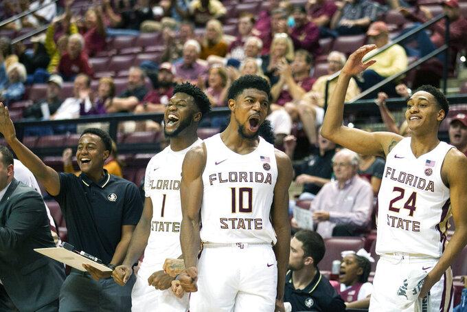 Florida State forward RaiQuan Gray (1), Malik Osborne (10) and guard Devin Vassell (24) react to a three pointer in an NCAA college basketball game against North Alabama in Tallahassee, Fla., Saturday, Dec. 28, 2019. (AP Photo/Mark Wallheiser)