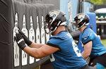 Jacksonville Jaguars center Tyler Shatley, left, performs a drill during an NFL football practice, Monday, June 14, 2021, in Jacksonville, Fla. (AP Photo/John Raoux)