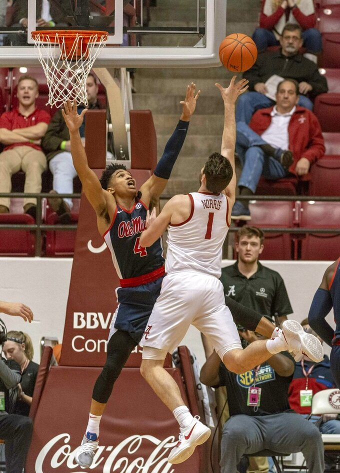 Mississippi guard Breein Tyree (4) defends a shot by Alabama guard/forward Riley Norris (1) during the first half of an NCAA college basketball game, Tuesday, Jan. 22, 2019, in Tuscaloosa, Ala. (AP Photo/Vasha Hunt)