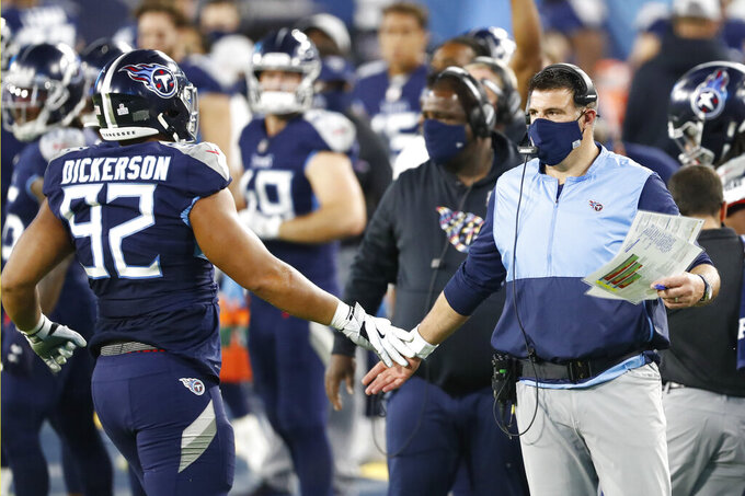 Tennessee Titans head coach Mike Vrabel slaps hands with defensive end Matt Dickerson (92) after a play against the Buffalo Bills in the first half of an NFL football game Tuesday, Oct. 13, 2020, in Nashville, Tenn. (AP Photo/Wade Payne)