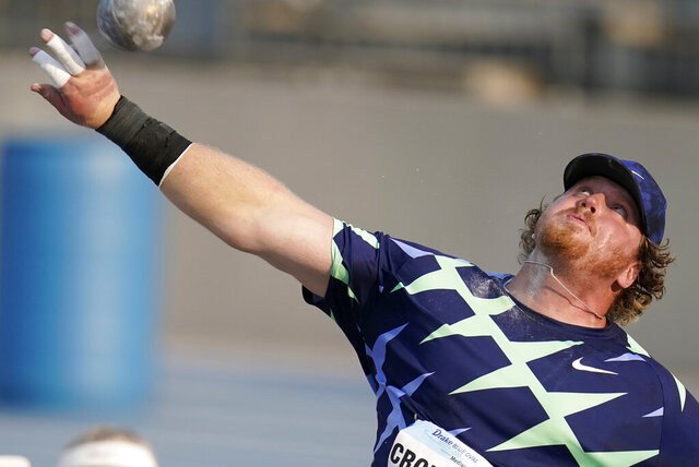 FILE—In this Aug. 25, 2020, file photo, Ryan Crouser puts the shot during the Blue Oval Showcase in Des Moines, Iowa. Crouser is one of the athletes who will be competing in the American Track League series, which begins a four-week run on Sunday, Jan. 24, 2021 in an indoor setting at the University of Arkansas.  (AP Photo/Charlie Neibergall, File)