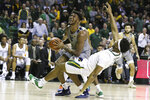 West Virginia forward Derek Culver, left, fouls Baylor forward Flo Thamba, right, while driving to the basket in the first half of an NCAA college basketball game, Saturday, Feb. 15, 2020, in Waco, Texas. (AP Photo/Rod Aydelotte)
