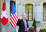 Russia's President Vladimir Putin waves as he leaves after the U.S.-Russia summit at Villa La Grange in Geneva, Switzerland, Wednesday, 16 June 2021. (Denis Balibouse/Pool Photo via AP)