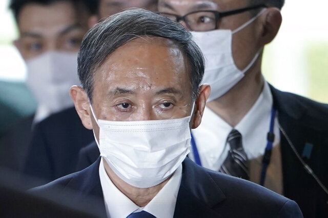 Yoshihide Suga arrives at the prime minister's office after being formally elected Japan's prime minister in a parliamentary vote, succeeding Shinzo Abe, Wednesday, Sept. 16, 2020, in Tokyo. (AP Photo/Eugene Hoshiko)