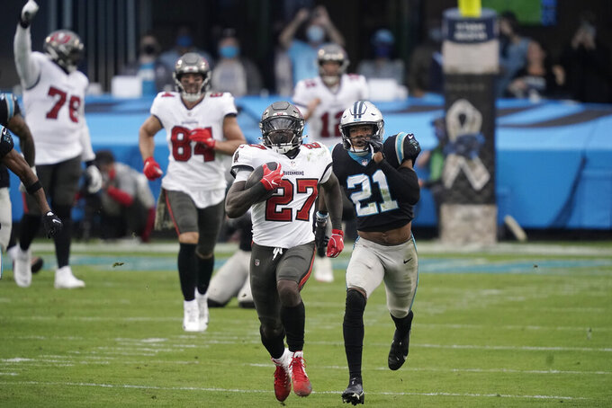 Tampa Bay Buccaneers running back Ronald Jones (27) runs for a 98-yard touchdown against the Carolina Panthers during the second half of an NFL football game, Sunday, Nov. 15, 2020, in Charlotte , N.C. (AP Photo/Gerry Broome)