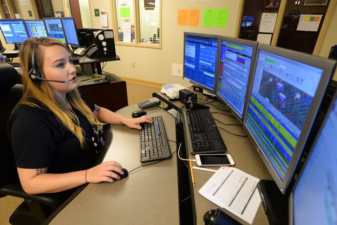 Lindsay Weidler, public safety tele communicator, answers a 911 call April 4, 2018, at the Erie County 911 Center in Summit Township, Pennsylvania. ( Jack Hanrahan/Erie Times-News via AP)