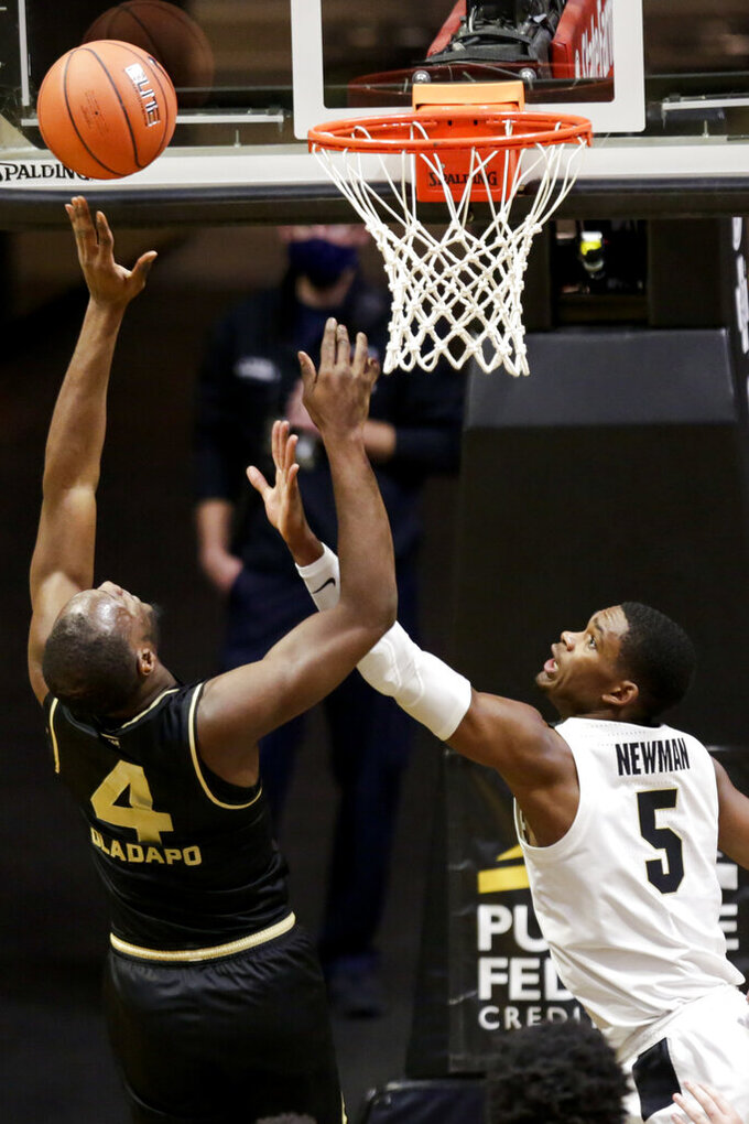 Oakland forward Daniel Oladapo (4) goes up for two against Purdue guard Brandon Newman (5) during the first half of an NCAA college basketball game Tuesday, Dec. 1, 2020 in West Lafayette, Ind. (Nikos Frazier/Journal & Courier via AP)