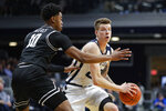 Butler forward Sean McDermott (22) looks to pass around Providence guard A.J. Reeves (10) in the first half of an NCAA college basketball game in Indianapolis, Saturday, Feb. 1, 2020. (AP Photo/Michael Conroy)