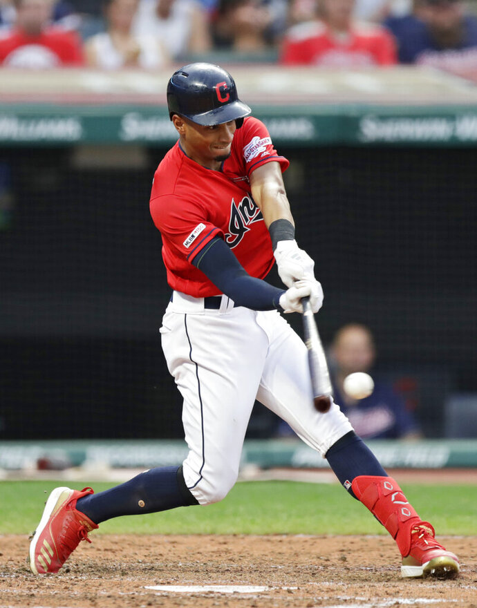 Cleveland Indians' Oscar Mercado hits an RBI double in the third inning of the team's baseball game against the Kansas City Royals, Friday, July 19, 2019, in Cleveland. (AP Photo/Tony Dejak)
