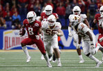 Washington State wide receiver Easop Winston (8) runs past Iowa State defensive end Spencer Benton (58) after making a catch during the second half of the Alamo Bowl NCAA college football game Friday, Dec. 28, 2018, in San Antonio. (AP Photo/Eric Gay)