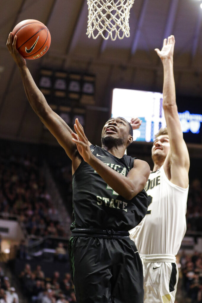 Chicago State forward Ke'Sean Davis (4) shoots in front of Purdue center Matt Haarms (32) during the first half of an NCAA college basketball game in West Lafayette, Ind., Saturday, Nov. 16, 2019. (AP Photo/Michael Conroy)